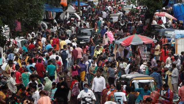 People are seen at a crowded market amidst the spread of the coronavirus disease (COVID-19) in Mumbai, India, July 28, 2021.