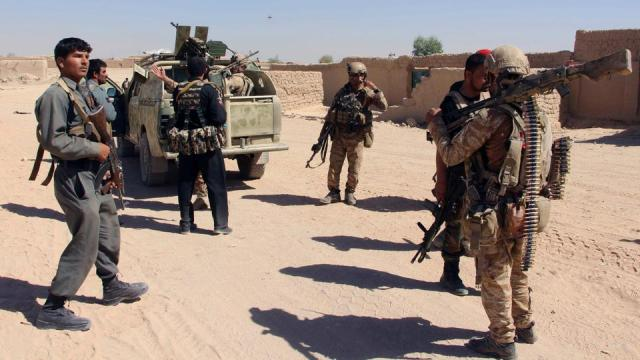 FILE: Afghan Special Forces and policemen prepare themselves for battle with the Taliban on the outskirts of Lashkar Gah, capital of Helmand in Afghanistan.
