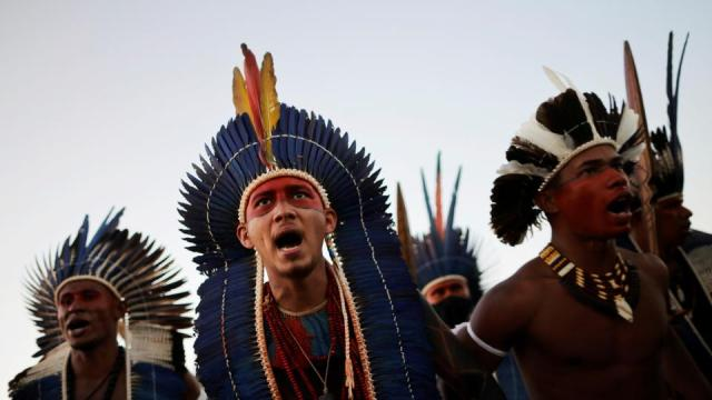 Indigenous people take part in a protest against a proposed bill allowing commercial agriculture and mining on protected tribal reservations, curtailing indigenous land rights, in Brasilia, Brazil on June 30, 2021.