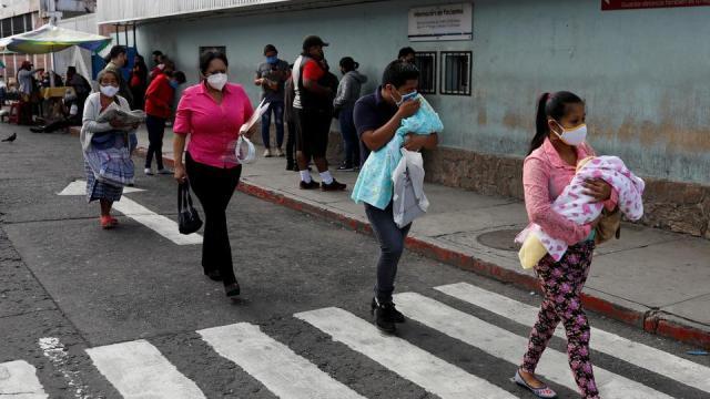People walk past the San Juan de Dios hospital as the coronavirus continues, in Guatemala City, Guatemala, July 15, 2020.