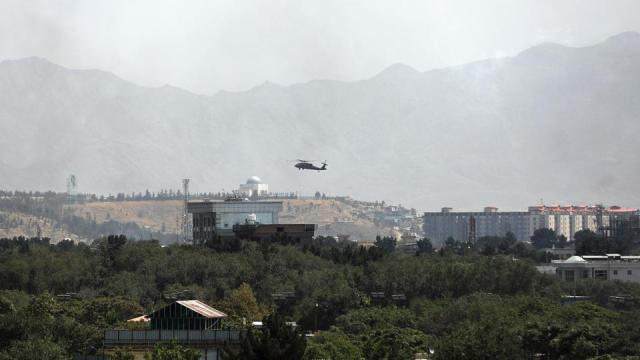 A. US Black Hawk military helicopter flies over the city of Kabul, Afghanistan, Sunday, August 15, 2021.