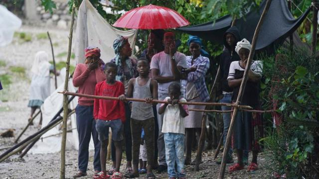 Earthquake-displaced people are exposed to the elements after Tropical Storm Grace swept over Les Cayes, Haiti, on August 17, 2021.