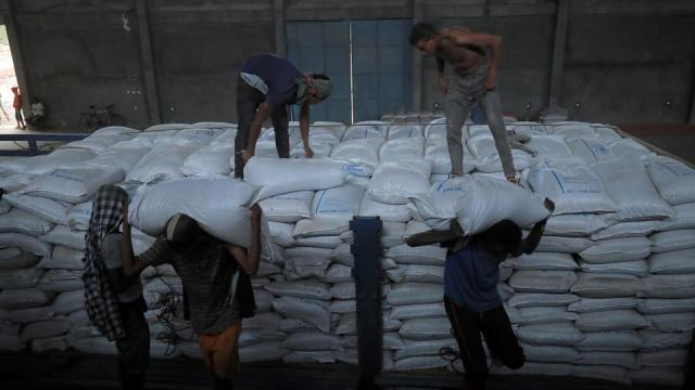 FILE PHOTO: Ethiopian porters unload food aid bound for victims of war after a checkpoint leading to Tigray in Mai Tsebri town, Ethiopia on June 26, 2021.