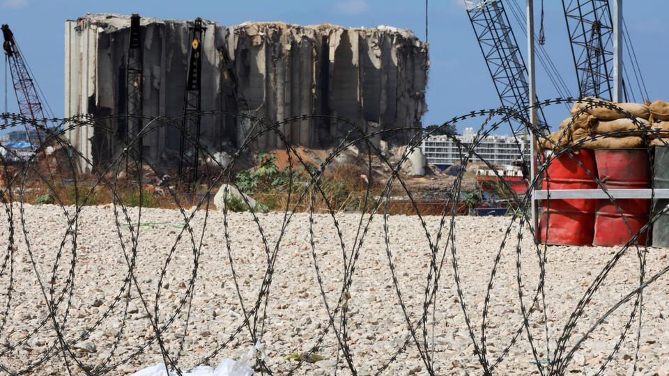 Razor wire is pictured in front of the site of the 2020 Beirut port explosion, Lebanon September 29, 2021.