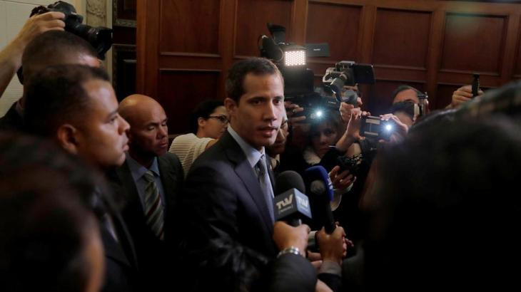 Venezuelan opposition leader Juan Guaido talks to the media after a session of Venezuela's National Assembly in Caracas, Venezuela March 6, 2019.