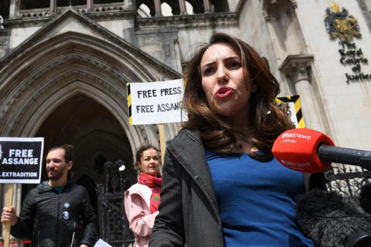 Julian Assange's partner, Stella Moris speaks to the media outside the High Court in London, Wednesday July 7, 2021. The UK High Court has granted the US government permission to appeal a decision that WikiLeaks founder cannot be sent to the US to face espionage charges.
