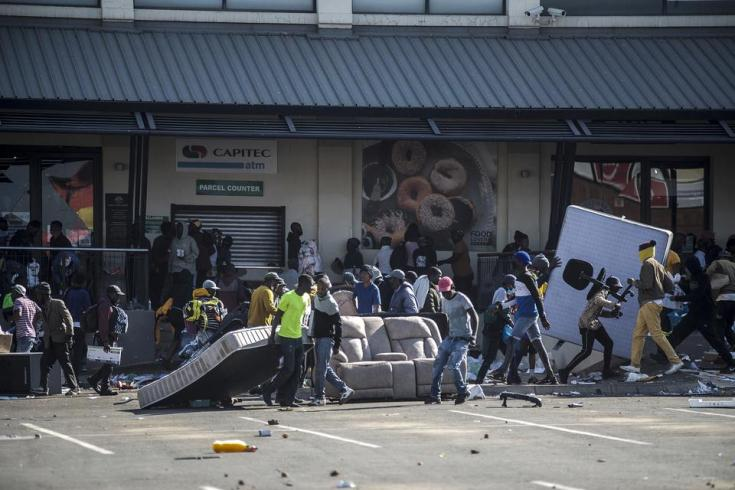 Rioters loot the Jabulani Mall in the Soweto district of Johannesburg on July 12, 2021.