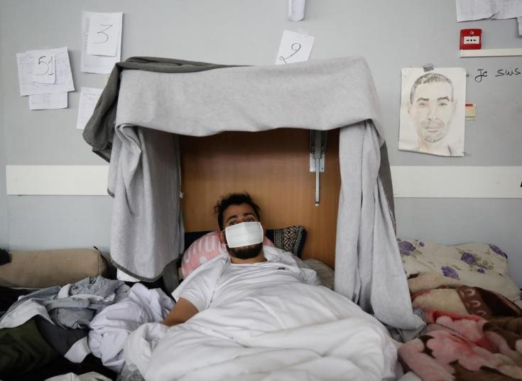 Moroccan Mustapha Magueri lies in a bed, as he takes part in a hunger strike for more than a month in Brussels, Belgium July 6, 2021.