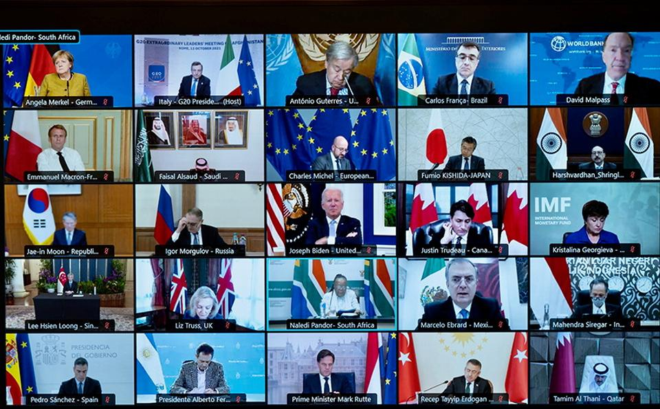A screen displays international leaders as they take part virtually in an extraordinary G20 leaders meeting on Afghanistan, in Rome, Italy on October 12, 2021.