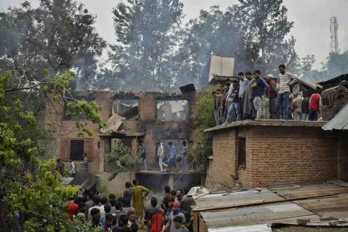 Three houses were burnt down by Indian forces in a gunfight in Nowshera, a village in south Kashmir's Anantnag district, on June 22, 2018. The forces shot dead four rebels and one civilian.