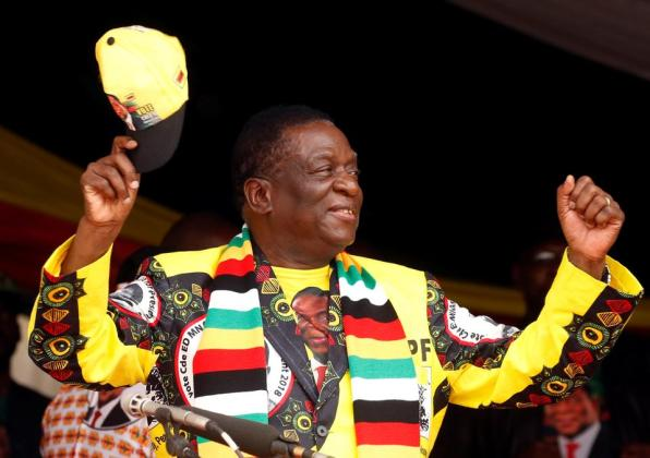 President Emmerson Mnangagwa greets supporters of his ZANU PF party at a rally in Murombedzi, Zimbabwe (November 24, 2018).