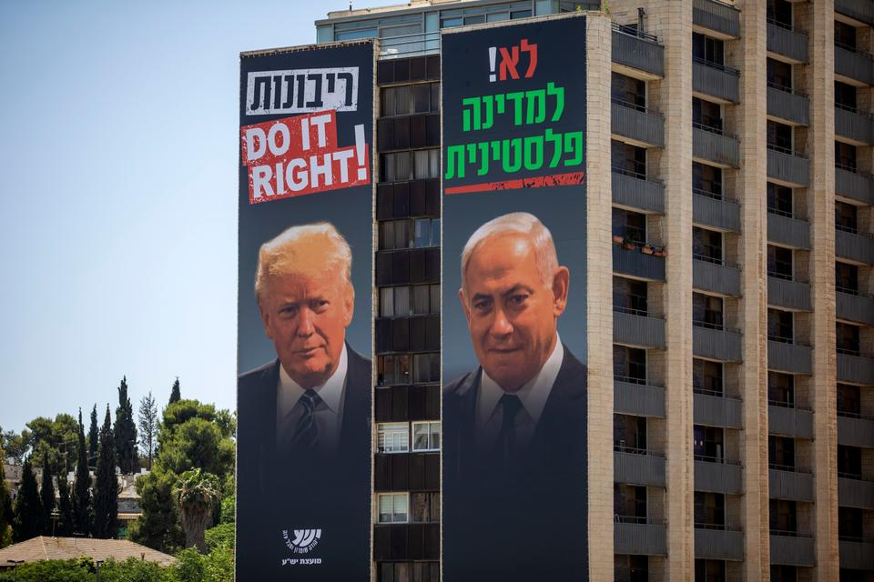 Billboards shows Israeli PM Benjamin Netanyahu, right, and US President Donald Trump in Jerusalem, placed in the West Bank, Wednesday, June 10, 2020. Hebrew on billboard reads