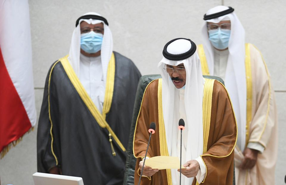 The new Emir of Kuwait Sheikh Nawaf al Ahmad al Sabah, middle, recites the constitutional oath at the Kuwaiti National Assembly in Kuwait, Wednesday, Sept 30, 2020. He was sworn in on Wednesday as the ruling emir of the tiny oil-rich country, propelled to power by the death of his half-brother after a long career in the security services. (AP Photo/Jaber Abdulkhaleg)