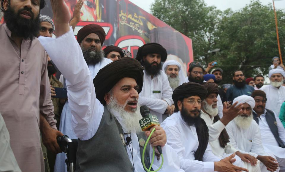 (File Photo) Pakistani radical cleric Khadim Hussain Rizvi addresses a rally against India in Lahore, Pakistan, Friday, Aug. 9, 2019. Thousands of activists held peaceful rallies across Pakistan to condemn India and its decisions on Kashmir.