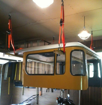 SUV roof suspended from ceiling
