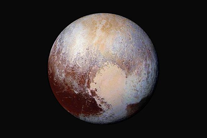 El planeta enano Plutón captado por la expedición New Horizons en julio de 2015