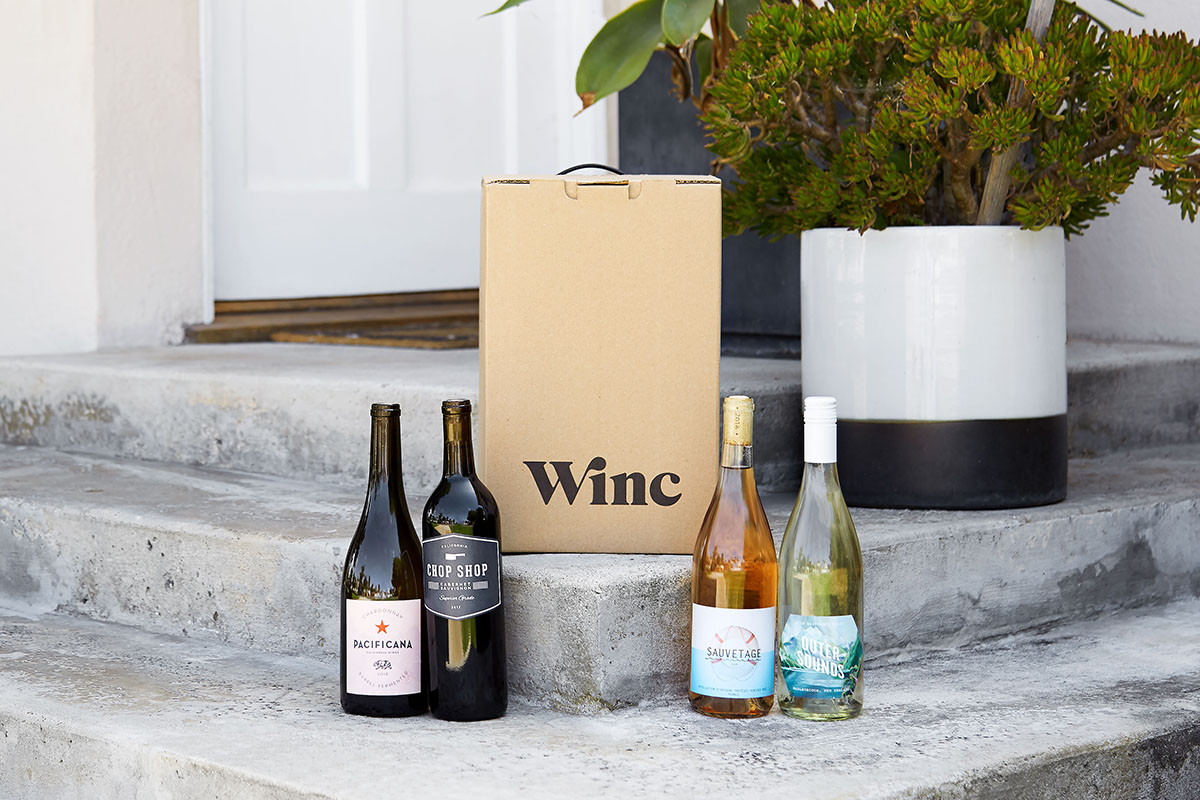 Four bottles of wine on a doorstep, with a