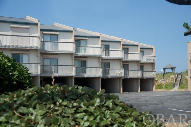 OCEANFRONT, 3 bedroom, 3 bathroom condo in the heart of Nags Head. The gorgeous, beach was included in the Nags Head beach nourishment and a stable dune offers wonderful protection. The home is well maintained and benefits from several upgrades. Tile floors, New HVAC, New Hot Water Heater, paint and decorated all in 2018.  Enjoy a beverage from the wet bar as you look out over the ocean from large private decks.  Spacious grand master with large bath and jetted tub.  Quiet enjoyment as you own all three levels, no neighbors on top or below.   Private interior laundry and lots of storage including a large storage area in the carport and outdoor shower. Fully furnished, the home is ready to be enjoyed and performs well in a rental program now.  Centrally located you can walk to restaurants, stores and entertainment. The Quay is a well managed and maintained complex featuring an outdoor pool, tennis court private beach access with dune top gazebos and beach showers to rinse off when you return home from the ocean on wooden boardwalks. Condo fees include water, sewer and cable.