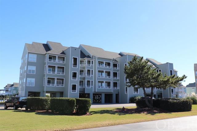 "Top Floor 2 Bedroom, 2 Bath furnished condo, vaulted ceilings, fireplace with a elevator and amazing views in the Outer Banks premier boaters community of Pirates Cove - Buccaneer Village. Open living area with Sound and canal views greet you when you walk in the door. Clear panoramic views from bedrooms. A spacious deck allows for enjoying outdoor breezes. Large storage ground floor lockup for all your beach toys. This home has been very lightly used.  A qualified boat owning buyer will have rights to a 35 ft boat dock slip for $130 a year. More than just a home, Pirates Cove is a lifestyle. ""Fishing, fun and friends"". Enjoy access to world class fishing and water sports. Association amenities include swimming pools, clubhouse, fire pit, volleyball, basketball, pavilion picnicking shelter, fitness center, marina that has over 4 miles of docks that are fantastic for walking or running, or just kick back and watch the boats come in from your deck or relaxing at the marina restaurant. Don't have a boat? No problem charter or walk just under the bridge to the NC Wildlife water access including fishing pier, boat ramp and multiple launch sites for small craft kayaks etc. This home allows for quiet enjoyment, while being walking distance to the fun.  New HVAC with WIFI thermostat and water heater in 2017."
