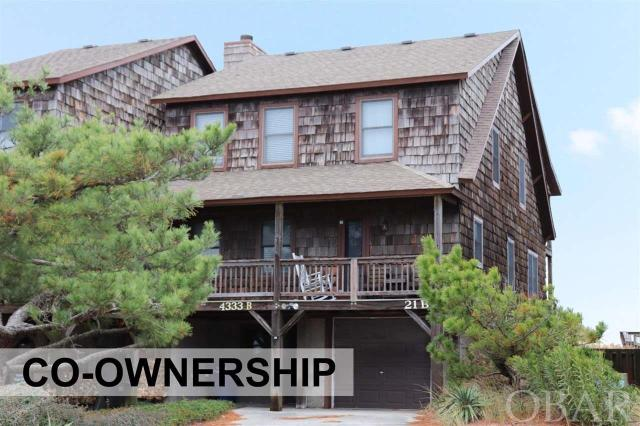 Easy, care free, remodeled and all inclusive oceanfront Co-ownership. This Duplex in Hawks Nest III covers all your needs. Own a 1/10 co-ownership or 5 rotating weeks in this beautiful oceanfront Nags Head home. Walk out your door to the beach and enjoy the ocean. Every year the weeks rotate so everyone can enjoy winter, fall, spring and summer in their home. Owners do trade weeks as well to fit their schedules with other owners. Hassle free, care free living is yours because the association dues pay for all expenses - taxes, insurance, cable, linens and all utilities. Beautiful Ocean Views from living room and master bedroom. Tastefully furnished 4 bedrooms, 3 bath, laundry area, outdoor shower, grilling area and garage with storage and owners lockable storage area. updated Master boast a huge jetted tub and separate beautiful custom tile shower and dual vanity. Decks front and back with expansive views. Spacious open floor plan.  Updated kitchen including granite, stainless and new appliances.  Open living area. What a great opportunity to vacation in an oceanfront home at a fraction of the cost. Owners may rent the weeks they chose not to enjoy themselves.  Schedule for 2019 is a s follows  Week of April 12TH-19TH July 26TH-Aug. 2ND Aug 30TH-Sep. 6TH Oct. 18TH-25TH Jan.17TH-24TH