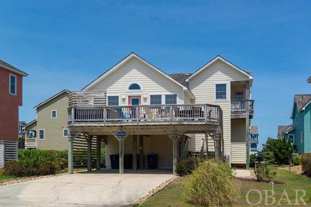 Real Estate 101 - Buy the best priced home in the nicest neighborhood with the greatest location!  Here is your chance.  Located steps away from the community pool and direct beach access, this 4-bedroom, 3.5 bath home is in the Villages of Nags Head's Seven Sisters.  Beautifully furnished and well maintained, this home offers a spacious living and dining area, king-sized master bedroom with spacious master bath and private balcony, and plenty of light.  The outside living areas include spacious covered decks, a spa, an outdoor shower, grilling area, and fish-cleaning station.  Residing in Seven Sisters is living a lifestyle of fun with amenities galore including two soundside parks with piers nearby for your enjoyment.  Also located near grocery stores, outlet shopping, fishing piers, great restaurants, a bike path and a walking trail that extends for miles. A beach and tennis club with a massive pool, children's pool, bath houses, game area, showers, club house and Nags Head Golf Links memberships are available. Use all or as little of the amenities offered in the Village and only pay for what you choose to use.  Free shuttle for you and your guests is available to most amenities.  Only a short trip to Jockeys Ridge or the Oregon Inlet Fishing Center and more.