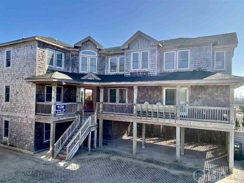 """EVERY BELL AND WHISTLE YOU CAN IMAGINE! GENERATING OVER $275,000 RENTIAL INCOME THIS YEAR! Perfect property for investors.  Summer Winds offers the charm of classic Nags Head architecture on a grand scale. This stunning 11-bedroom home is a TRUE DREAM HOUSE boasting a 17 SEAT HOME THEATER with 120"""" SCREEN, GAME ROOM, GYM, HEATED 22X10 POOL, HOT TUB, 8 MASTER SUITES and ELEVATOR.  The kitchen is well equipped, and the open concept top floor is perfect for family and friends to gather after a day enjoying the stunning beach just outside the door.  It is easy to see why families return to this home year after year for vacation.  2021 UPDATES - NEW THEATER SEATING -NEW TVs - Refelting Pool Table"""