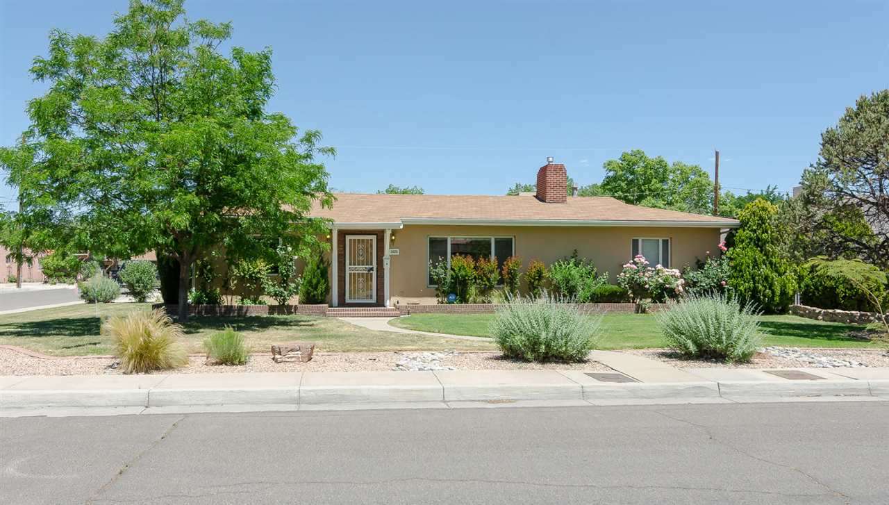 Motivated Seller! Right in the Heart of the Albuquerque Country Club Neighborhood is this Spacious Mid Century Modern Home w/ Charm & Character. 3 Bdrms,3 Baths,2 Car Garage. Beautiful Refinished Hardwood Floors, Bright Open Floor Plan, Private Backyd w/ Covered Patio & Storage Blding/Workshop add to the Livability of this Lovely Home. Spacious Kitchen w/ Brkfast Area, Formal Dining Area, Multiple Living Areas. Two Custom Fireplaces. Separate Master Bedroom has Updated Bath w/ Garden Tub, & Large Walk In Closet. Two additional Bedrooms Share a Charming Bathroom in the Hall. An Additional Full Bathroom located just off the Kitchen near the Utility Room. Corner Lot w/ Backyard Access. Beautifully Landscaped w/ Grass & Blooming Plants. You will feel right at Home. Elementary school is Lew Wallace, Middle school is Washington.