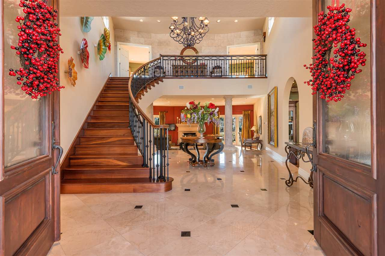 Sited on a spectacular golf course lot, this custom Tanoan home will delight the senses. Upscale & updated in every way this home is ready to move into. Elegant foyer with marble floors & sweeping staircase lead you to comfortable living spaces. Main living area has french doors to back yard & views of golf course, large formal dining room & library await many gracious gatherings. Master suite is stunning with fireplace, balcony overlooking golf course, elegant bath & custom closet plus 2 adjoining offices . Three other bedrooms are located on the first floor, Two have a jack & jill bath and french doors to the yard. The other bedroom with ensuite bath is separated from others & could be used as a guest suite or in law quarters. Gourmet kitchen opens onto patios perfect for summer!