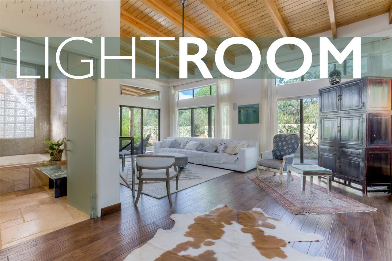 Exquisite Designer Dream Home. Spacious, light-filled open living. 2567sf 2BR Main + Full Guest House + Studio on ½ Acre = Room to Spread Out! Rebuilt in 2008 w/many Green features: Low VOC Paint, Hickory Floors, Reclaimed Wood Counters & Benches. Unique Glass Doors & Hardware. Variance plastered walls, recycled glass tile. 2 swamps + forced air, hot water solar panel, passive solar blower & a wood stove. Linear & LED lighting. 4-zone speaker system • Built-in TV w/Wifi surround + a low volt Sec. System. Custom Birch cabinets w/Euro-hardware. Fire-torched black granite counters & sandblasted island. 2 Fridges, gas cooktop + GE stackable W/D. Ample exterior storage. Extensive mature xeriscaping w/grey water irrigation, gardens & grape vines. 2017 New Septic & Elastomeric Roof.