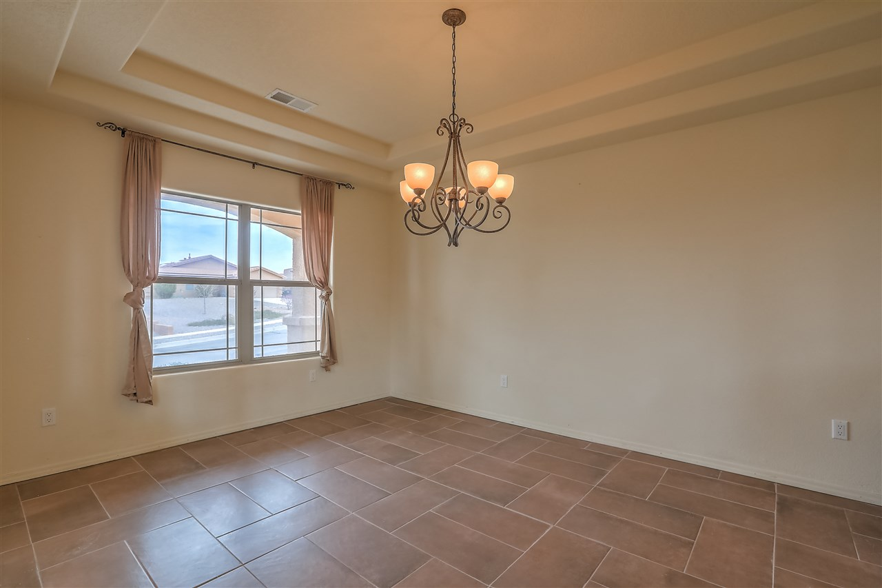 Beautiful Open Floorplan with the Master Downstairs. Grand staircase to upper level loft and 3 guest rooms. Soaring ceilings, kitchen with granite and breakfast nook. Family room for entertaining. A three car garage for all your cars and toys.