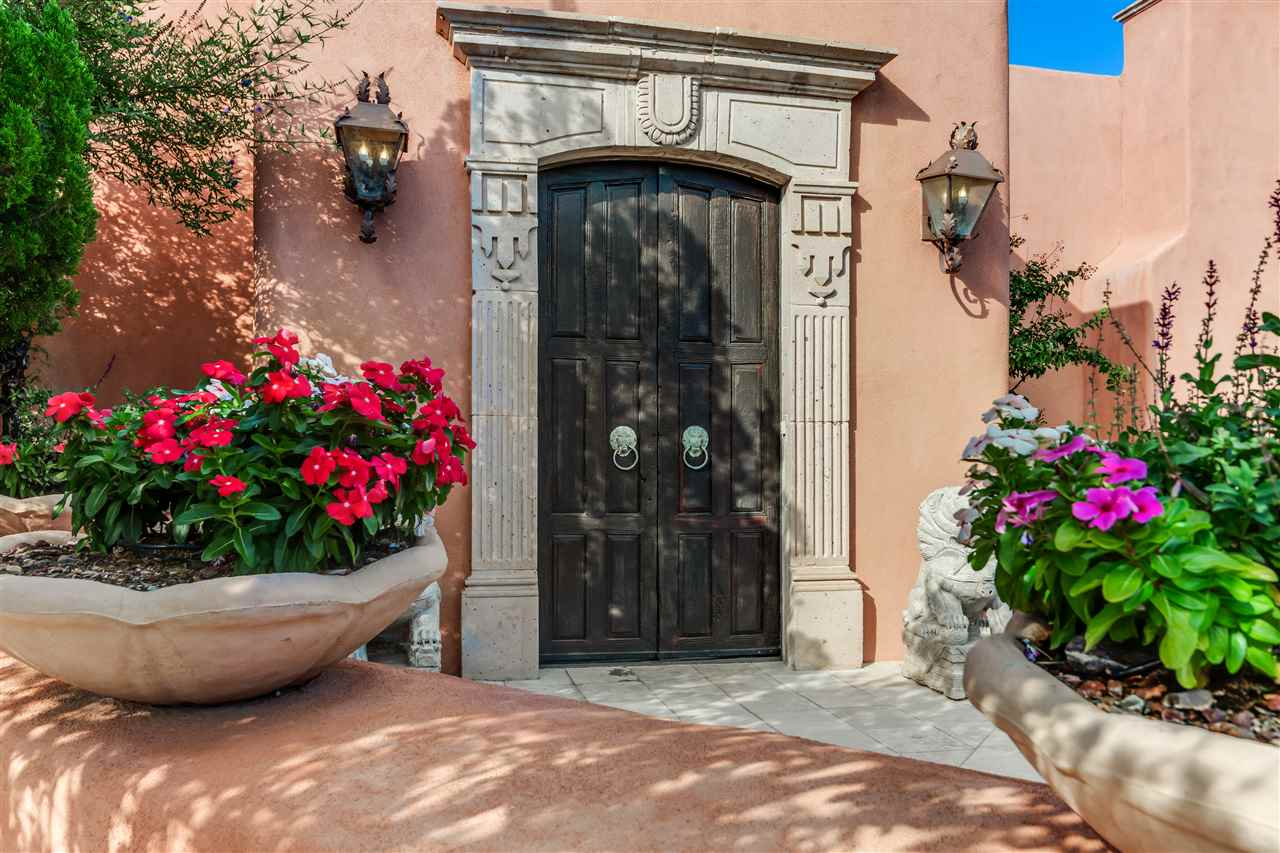 Reminiscent of the haciendas of San Miguel de Allende, this custom Corrales home offers magnificent views of mountains, city lights, and the valley below. Built around a central courtyard with attached guesthouse, the home is filled with light, tile floors and the ambience of Spanish Colonial Mexico with all of the conveniences of today. 4-5 bedrooms with ensuite baths, no steps. Large living spaces, luxurious master suite with spacious master retreat, and spa like bath with his and hers closets. Formal living room and dining room with magnificent views and doors onto the outdoor living space with outdoor kitchen. Large gunite pool overlooking the views make this home exquisite for entertaining. Plaster walls throughout, informal family room with bath, exercise room. Separate inlaw suite.