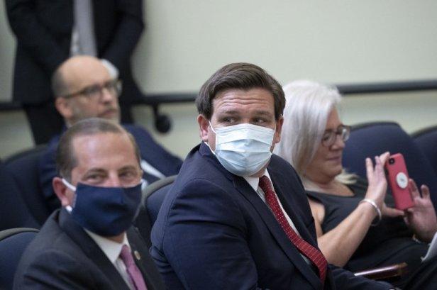Republican Governor Ron DeSantis (C) signed an executive order last month banning school mask mandates. File Photo by Stefani Reynolds/UPI