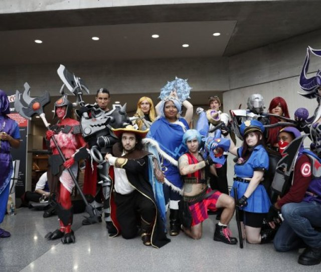 People In Costume Stop For A Group Photo At New York Comic Con At The Jacob K Javits Center On October 8 2016 In New York City