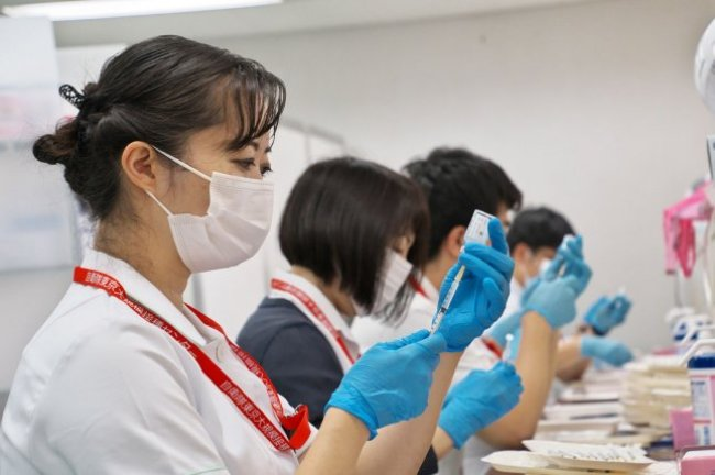 A medical worker prepares a dose of Moderna's coronavirus vaccine at a large-scale COVID-19 vaccination center in Tokyo, Japan, on June 18. File Photo by Keizo Mori/UPI