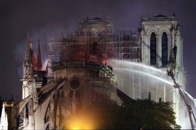 Firefighters battle to extinguish the giant fire that engulfed Paris' Notre Dame Cathedral on April 16, 2019. File Photo by Eco Clement/UPI