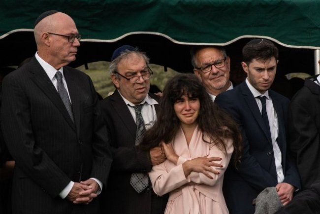 Members of the Kaye family, daughter Hannah (C) and her father, Howard (2nd-L), along with other mourners attend the funeral service for Lori Gilbert Kaye at El Camino cemetery in San Diego, Calif., on April 29, 2019. Kaye was killed at the Chabad of Poway Synagogue. File Photo by Ariana Drehsler/UPI