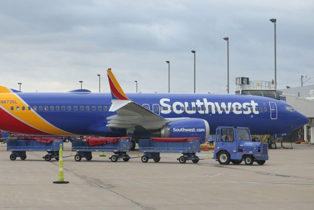A baggage cart passes a Southwest Airlines 737 Max 8 airliner Wednesday at St. Louis-Lambert International Airport in St. Louis, Mo. Photo by Bill Greenblatt/UPI   License Photo