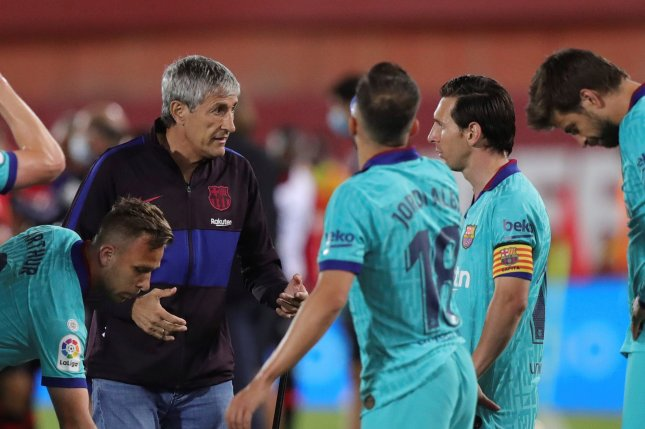 FC Barcelona coach Quique Setien's relationship with players is strained after the Spanish soccer club slipped from first place in the La Liga standings. Photo by Juanjo Martin/EPA-EFE