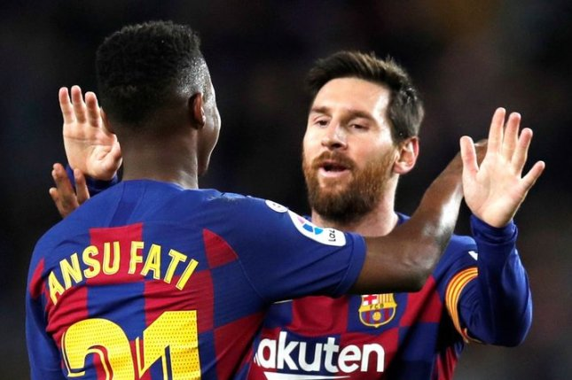 Ansu Fati (L), who previously wore Nos. 22 and 17, will switch to No. 10 after the departure of star teammate Lionel Messi. Photo by Alejandro Garcia/EPA-EFE