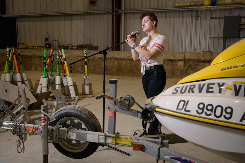 "Sydney Cargill, member of the a capella group DelReMi, says she's ""transported to a different world"" when she sings, which she does even while at work in the Coastal Engineering Lab, pictured here."
