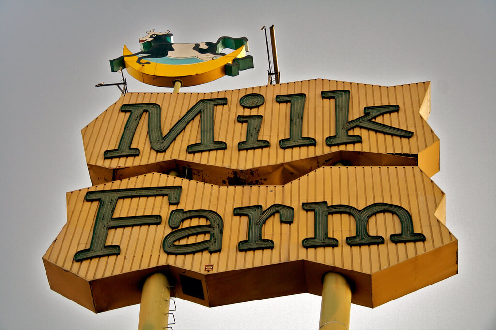 photo of vintage cow sign