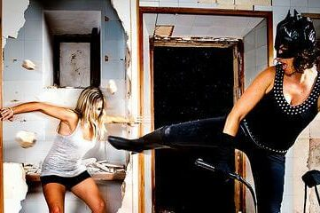photo of a person dressed up as Catwoman having a fight with another person