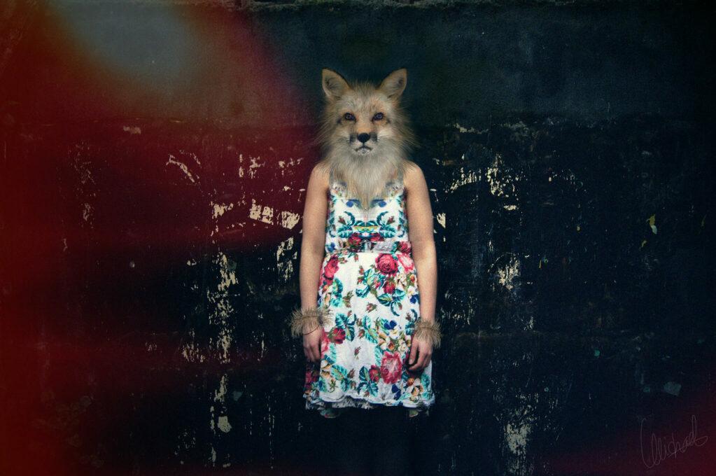 photo of woman with fox head