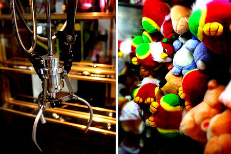 photo of claw machine with stuffed animals