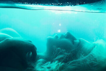 photo of woman underwater