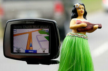 photo of dashboard hulu dancer next to GPS