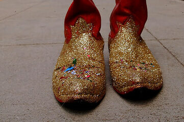 photo of red cowboy boots with gold sparkles on the toes