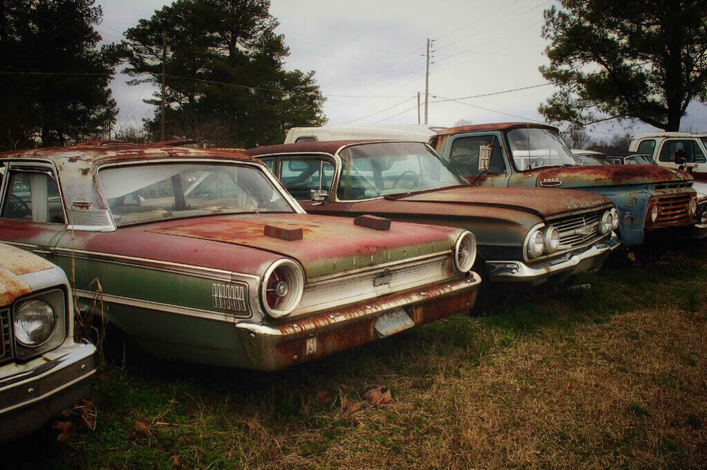 photo of rusting cars