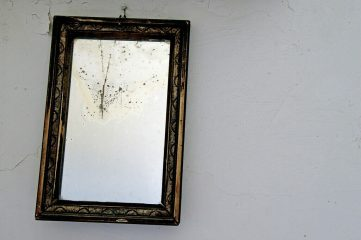 photo of old mirror on wall