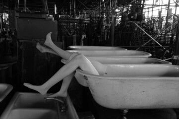 photo of mannequin legs sticking out of clawfoot tubs